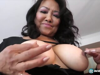 Mandy Thai is squeezing her tit while masturbating, because it feels much better like that asian asian